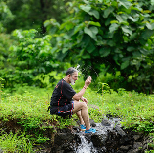 A runner takes a time out at Durshet Forest Maratahon.