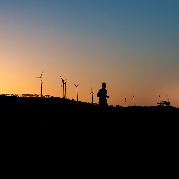 Silhouette of a runner at sunrise in Nagar Rising Marathon, Ahmednagar.