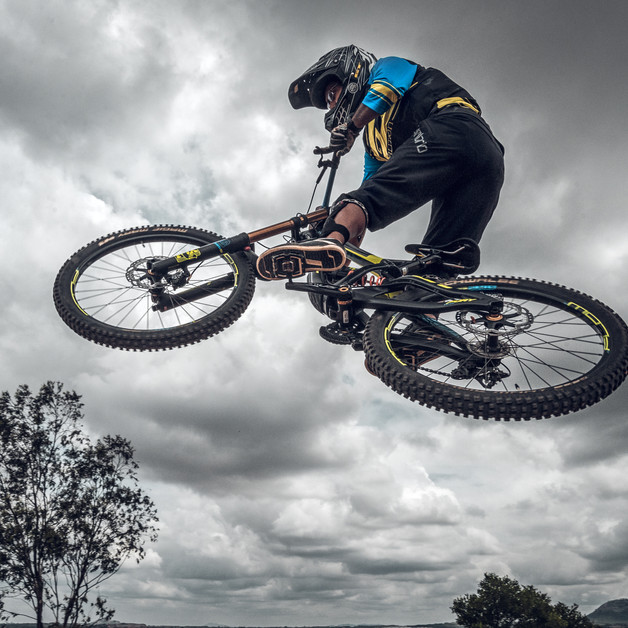 Nilesh Dhumal jumps over a route obstacle in BBCH MTB downhill race, Bengaluru.