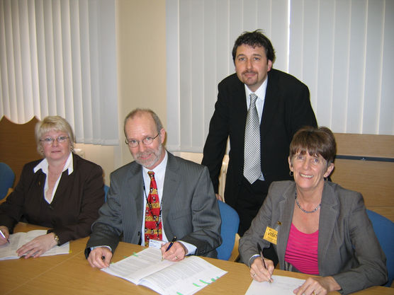Brian & Board Sign Transfer Documents