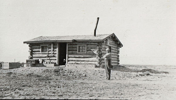 Rising, Charlie and his log home 1917.JP