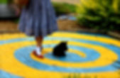 Dorothy begins her journey on the Yellow Brick Road.