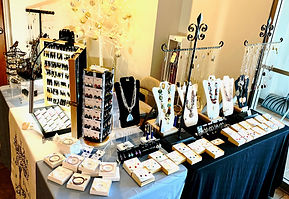 Try on one of a kind jewelry by Kristin Krull at a jewelry trunk show
