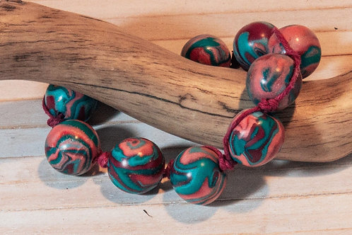 Bracelet with handmade polymer clay beads, with a cute polymer clay toggle closu