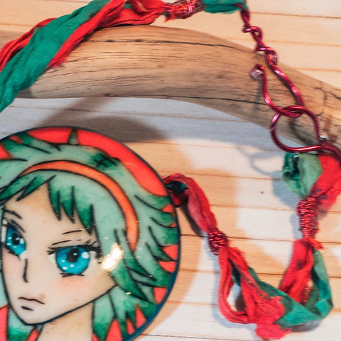 Bold handmade necklace with a large colourful polymer clay pendant picturing a m