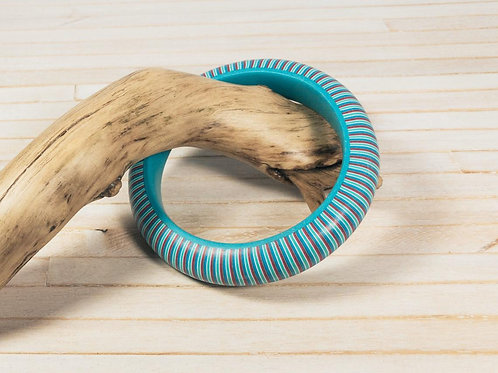 Polymer clay bangle bracelet, with a well-sanded silky smooth finish, and stripe