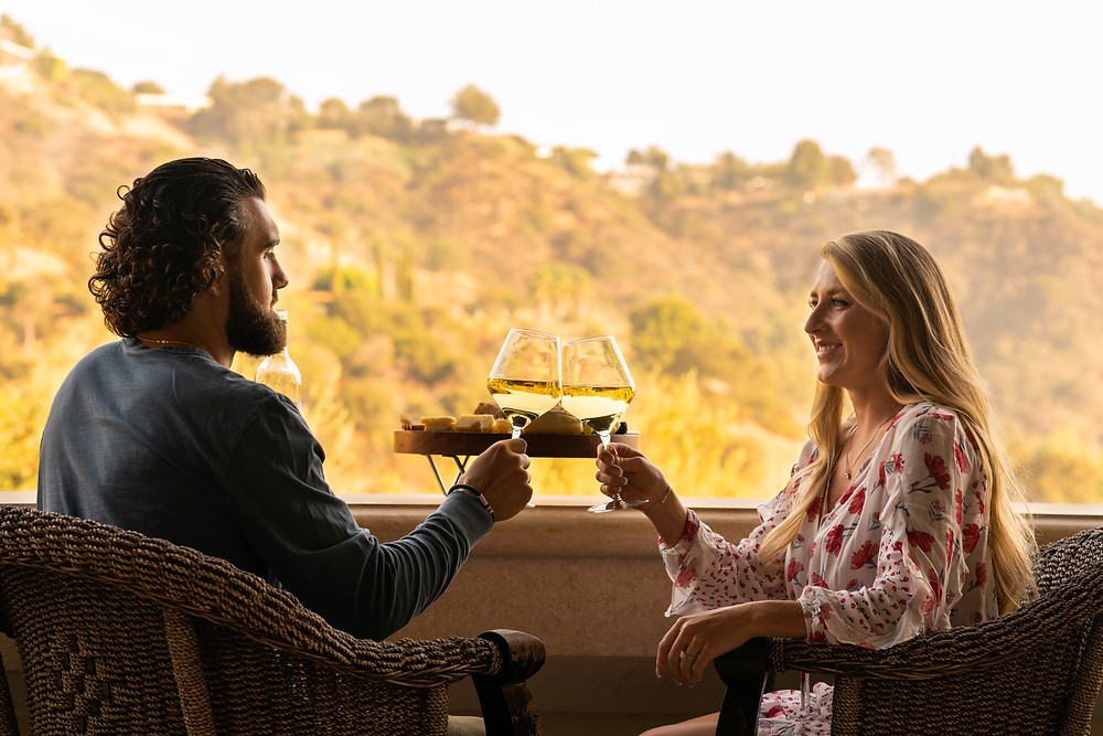young couple, enjoying a glass of wine bought from Yahyn because they wanted to help a small vineyard out.