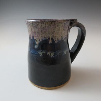 Mug in Black with a flowing Lavender Rim