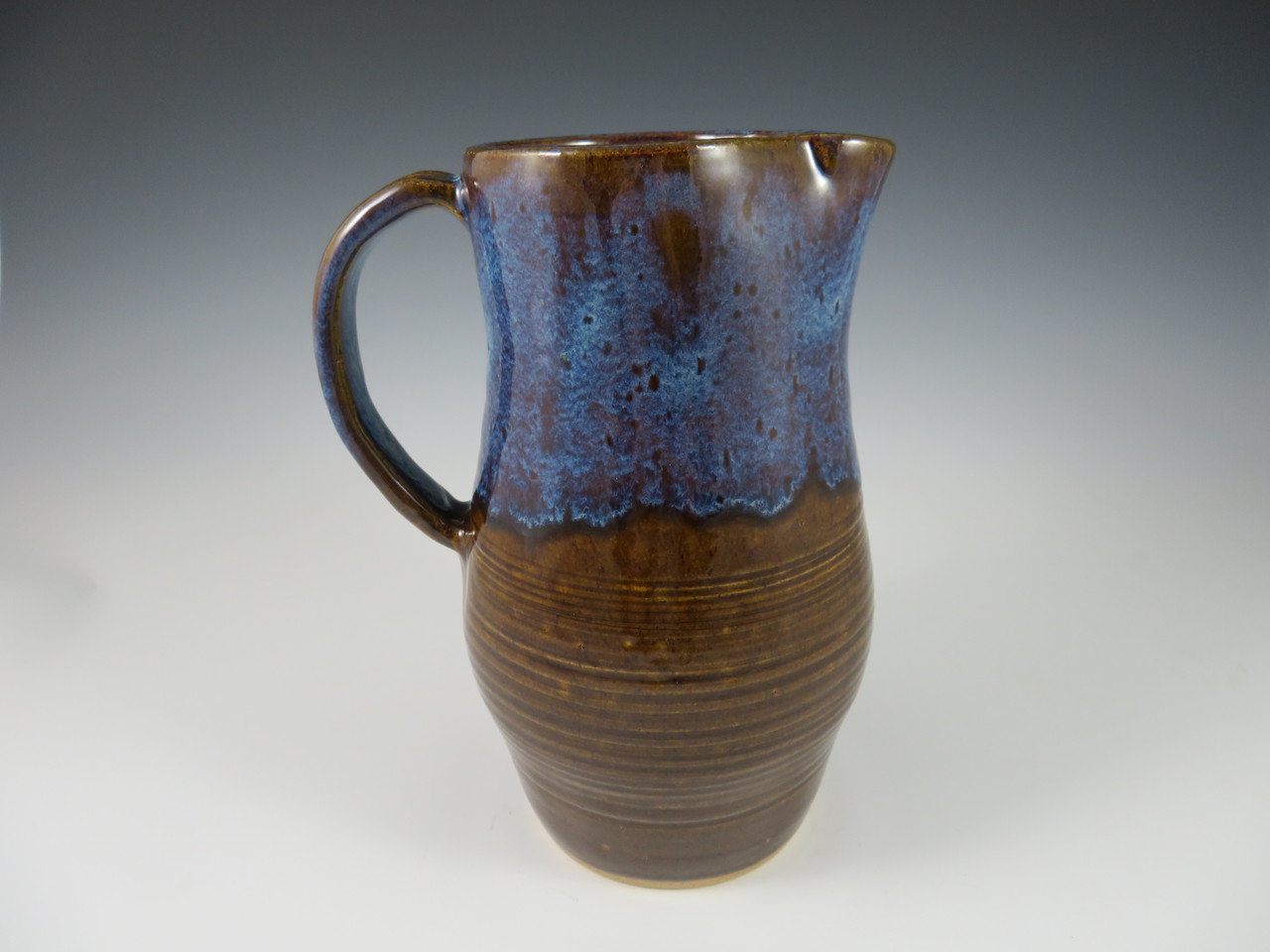Pitcher in Brown with Blue Rim