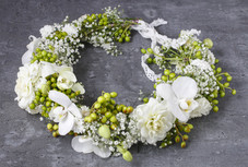 Flower wreath with carnations, orchids a