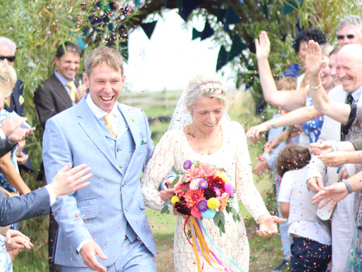 Alex and Lucy's bold and bright Festival wedding