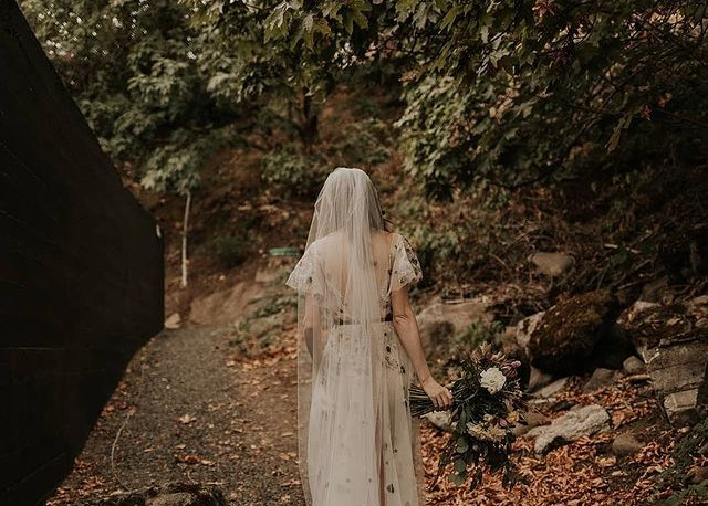 Bride standing outside at The Ruins