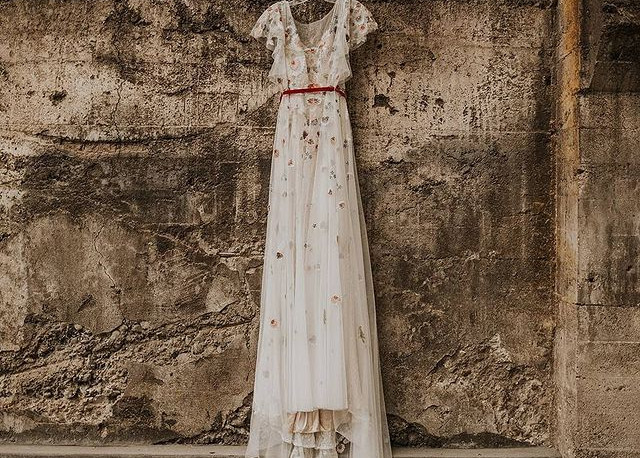 Wedding dress hanging outside at The Ruins