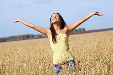 Photo of a happy woman in a field
