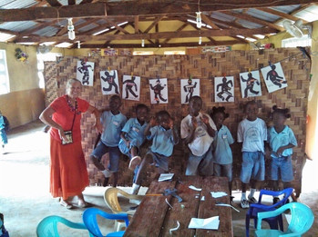 Jean with students after an art project in Lungi