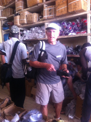 Joe helps buy shoes in Freetown for Lungi school students