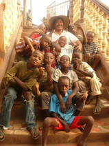 Master builder, Enrique, hams it up with Wilberforce neighborhood kids