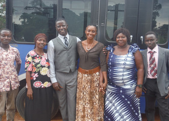Pastor Fayia and wife Ashley (middle) with Door Academy teachers