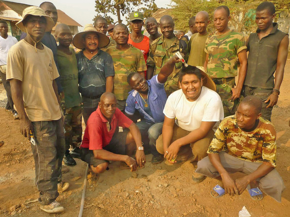 Emanuel poses with military construction team in Wilberforce, 2012