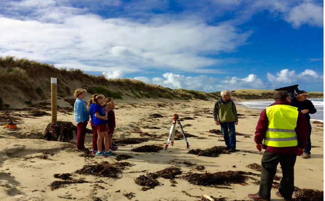Primary school children with PFCG on the beach