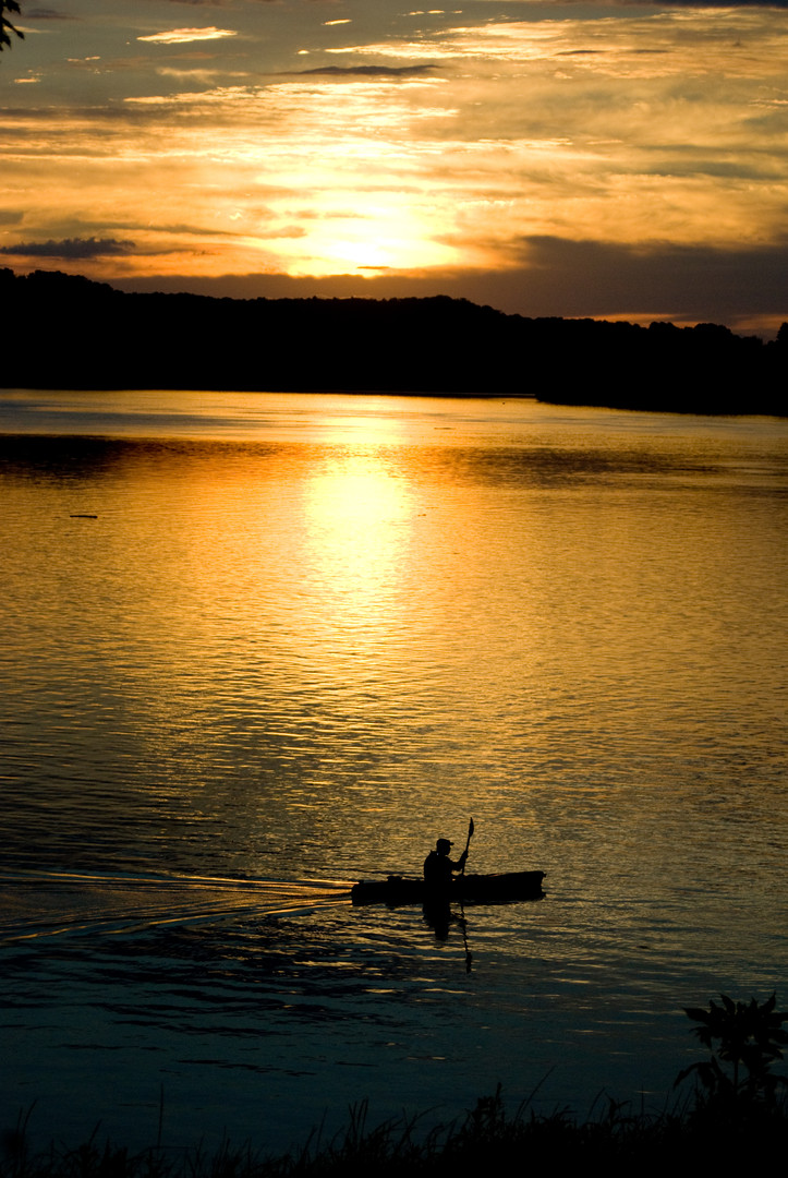 Kayak on river evening.jpg