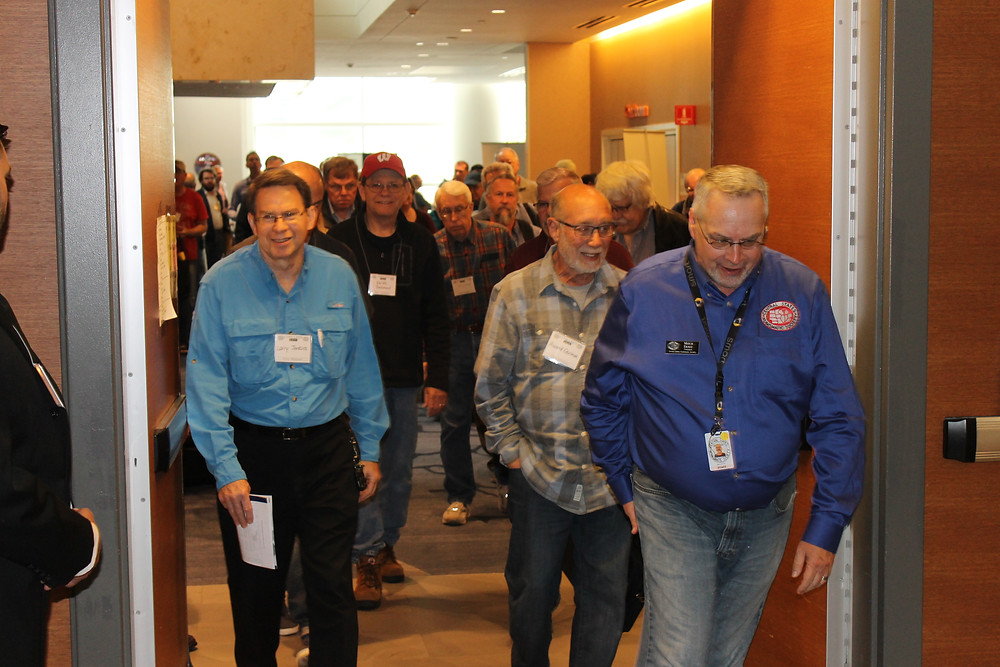 Central States President Mitch Ernst opening the doors to the bourse floor for a large crowd of attendees.