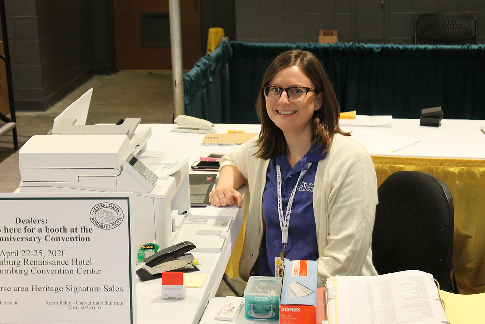Central States Secretary and Bourse Chairman Patricia Foley sitting at the Central States table smiling.