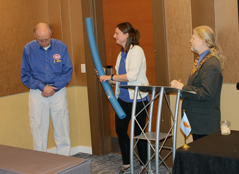 Convention Chairman Kevin Foley being hit with a pool noodle by Central States Secretary Patricia Foley at the Bermanian Numismatists meeting.