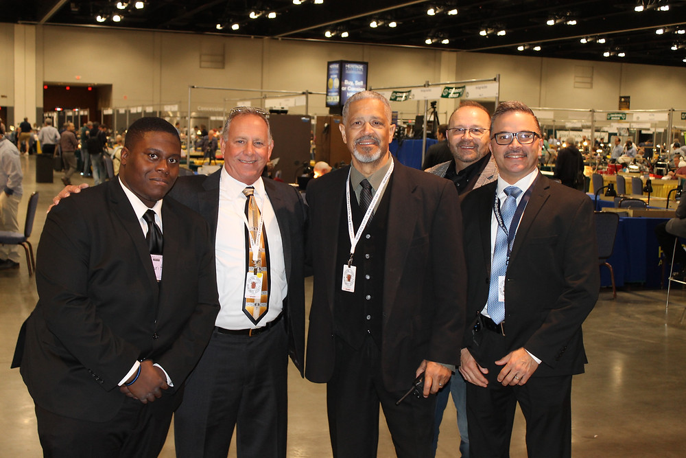The five security guards in suits on duty for the 80th Anniversary Convention.