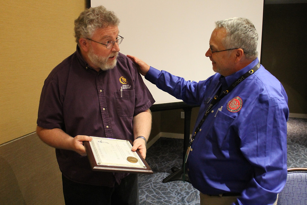 Central States President Mitch Ernst presenting the Sower Award to American Numismatic Association staff member Rod Gillis.