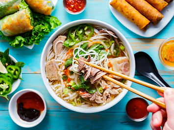 eating colorful Vietnamese pho bo with s