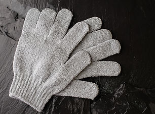 Gray exfoliating gloves for shower use o