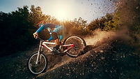 Downhill mountain bike. Young man cyclis