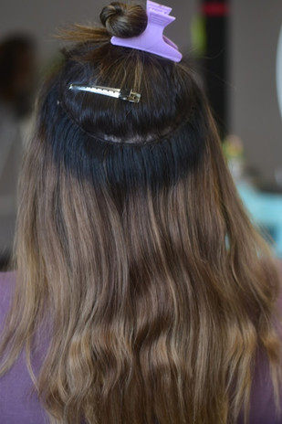 An exposed row.  This shows you how the extensions sit along your scalp for a comfortable, natural feel.