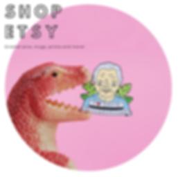 Dinosaur toy holding a David Attenborough enamel pin in it's mouth