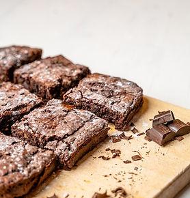 closeup-freshly-baked-brownies-wooden-bo