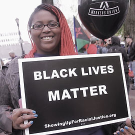 Erica With BLM Sign Button.jpg