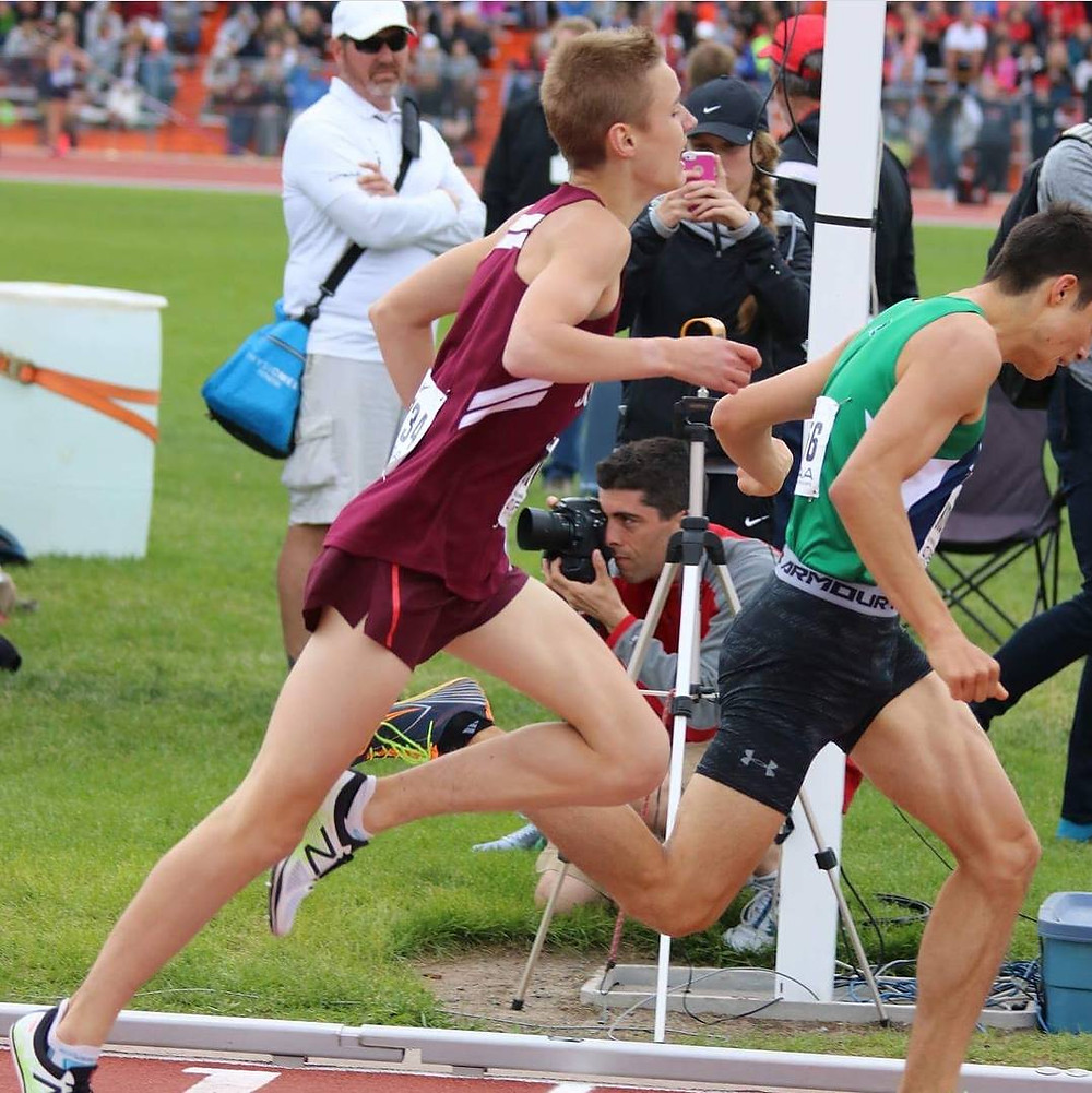 Evan Burke of South and Kyle Koyanagi of Laurier battle for the finish line at OFSAA 2017