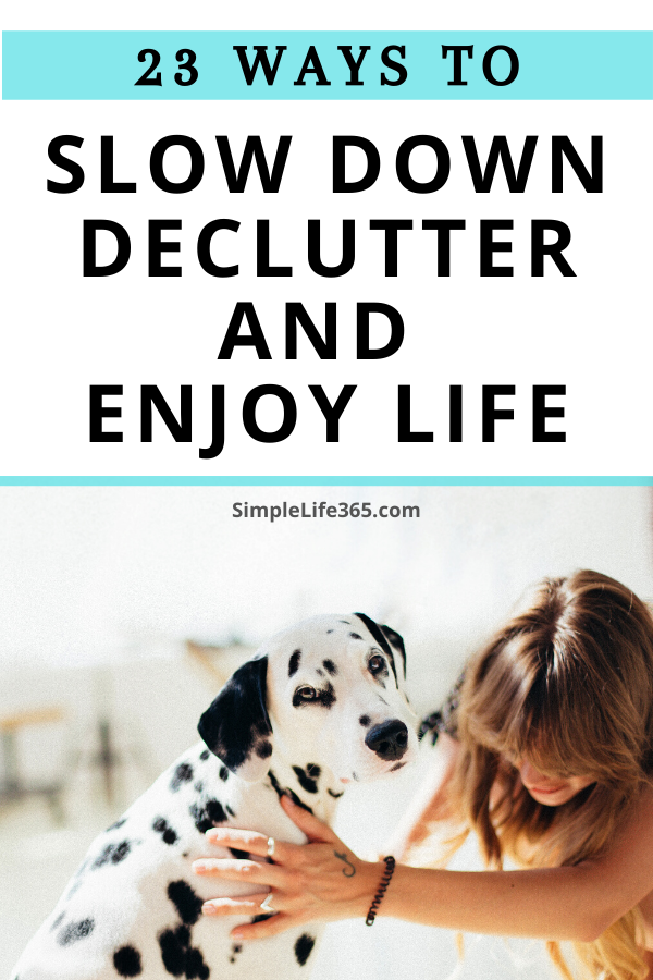 Woman leaning down to pet a dalmatian