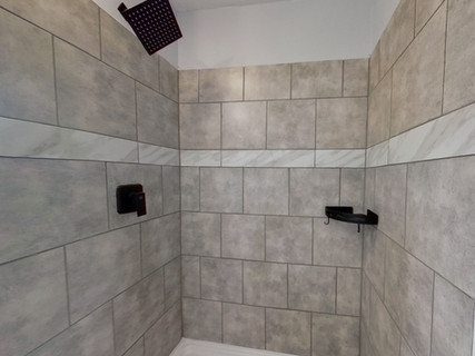 custom tile shower matte black accents