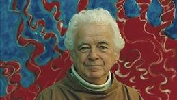 Benjamin Creme devant une de ses peintures