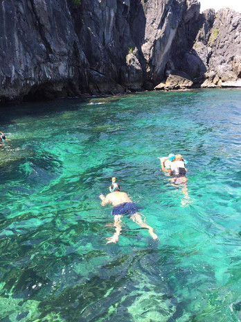 Snorkeling and diving in a clear sea