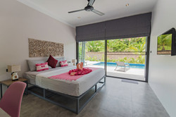 Pink bedroom with king size bed