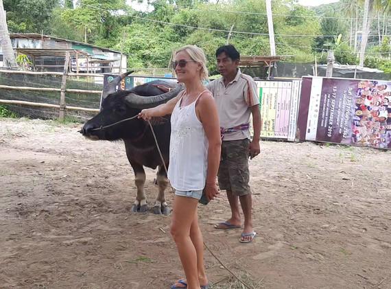 Emma with a buffalo trainer