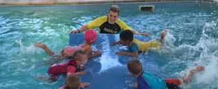 Rikki swimming with toddlers.