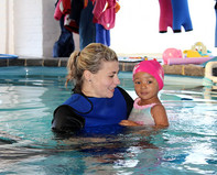 Rikki with swimming toddler