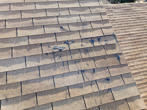 What it looks like after homeowner attempts to repair shigles