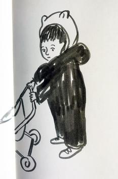 Bear pushing his pram