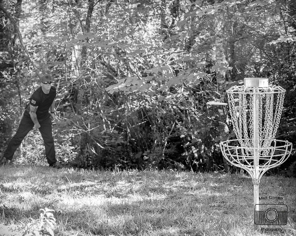 Christchurch Disc Golf Dad Leon Botha nails one