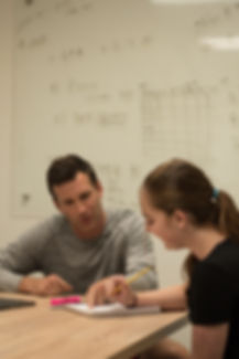Brandon Slade, owner of Strid Learning, during a weekly mentor meeting with a student